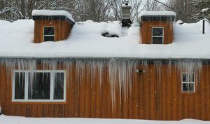 Ice dams growing on roof.